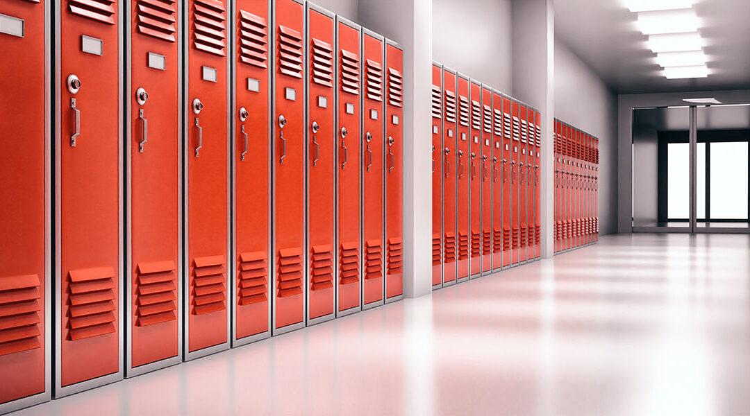 Red school lockers in hallway
